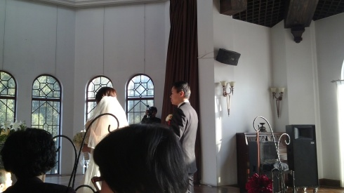 The most western of the weddings I have gone to (and the most recent), with separate vows, time to chat and then food at the end.  This one also had a flower girl/boy who absorbed the attention of all.