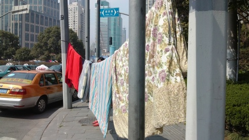 Hanging laundry with high rises in the background