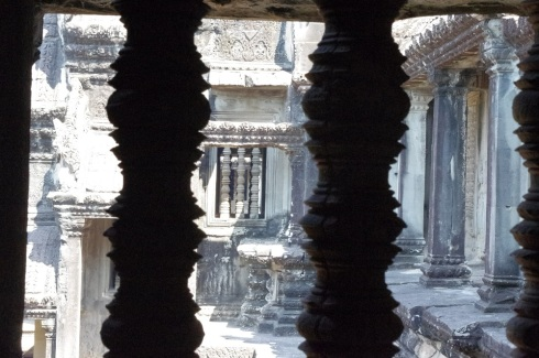 Peering through the columns into one of the pools (now dry)