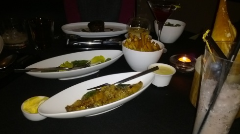 Our side dishes to share with my steak in the back with a luscious sauce