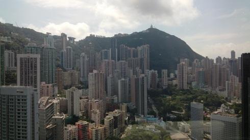 Sun streaking through the clouds over Hong Kong Island
