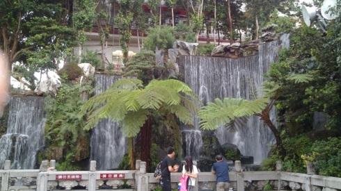 A peaceful waterfall near the entrance