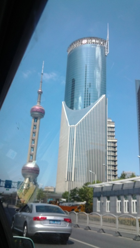 A snap out of a cab window - the pearl tower with a couple puffy clouds behind