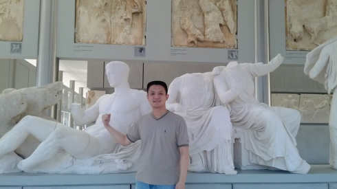 Posing with the reconstruction of the frieze on the top of the Parthenon