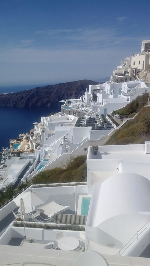 The white roofed houses and the blue sea and sky