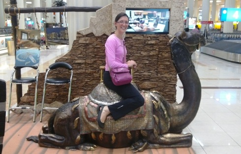 What other airport lets you pose with a camel while you are waiting for your bag?